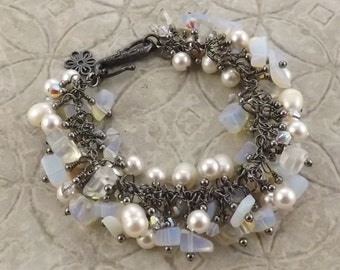 Magnolia blossom white gunmetal gemstone pearl and Swarovski crystal bracelet perfect for brides