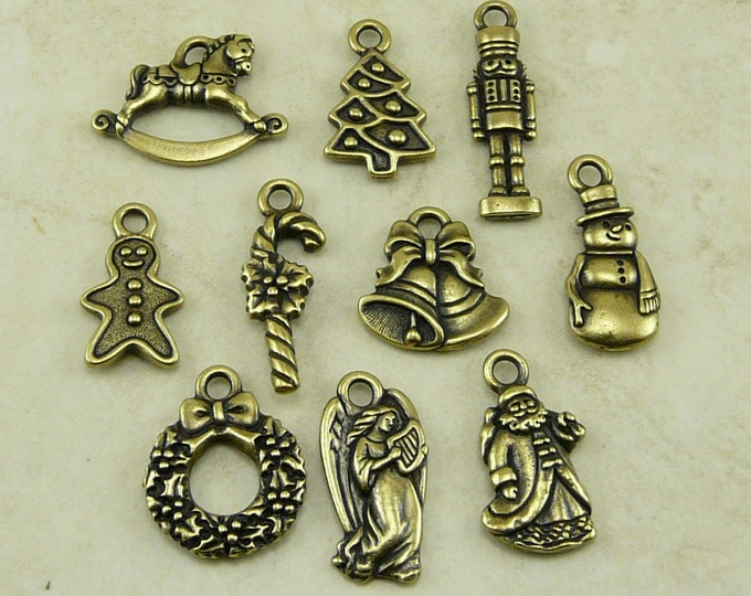 Featured listing image: 10 TierraCast Christmas Holiday Charms Mix Pack - Santa Angel Bells Candy Cane - Brass Ox Plated Lead Free Pewter - I ship Internationally