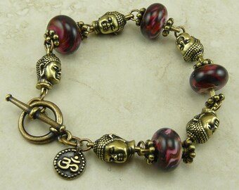 Buddha Head and Ruby Swirl Lampwork Glass Bead Bracelet - Vintage Brass Ox beads and findings - I ship Internationally