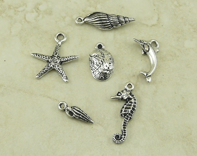 Featured listing image: 6 TierraCast Ocean Life Sea Shell Dolphin Seahorse Charms Mix Pack > Silver Plated Lead Free Pewter - I ship Internationally 2373