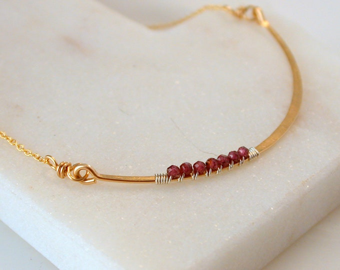 Garnet Adorned Curving Bar