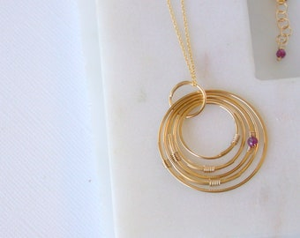 Ruby Gemstone Orbit Necklace. July Birthstone Necklace. Ruby Pendant. Gold Circles Necklace. Ruby and Gold Necklace.