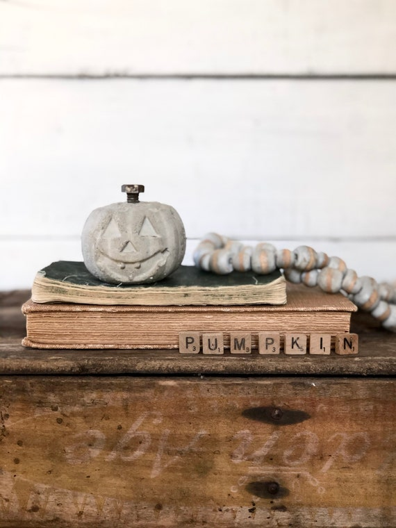 Small Concrete Pumpkin Halloween jack-o-lantern with rusty bolt stem red vintage paint