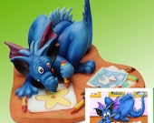 Budding Artist, Little blue Dragon Figurine by L. A. Berry,   Sculpture of a little Dragon drawing pictures.  FREE NOTE CARD included!