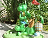Dragon Golfers Figurine by L. A. Berry,   Two dragons playing golf.  A Difficult Putt.  FREE NOTE CARD included!