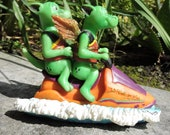 Dragons on a Jet Ski Figurine by L. A. Berry,   Dragon Twins having fun on the river.  MATCHING CARD included!