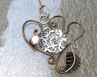 Mixed metal one of a kind pendant with white topaz