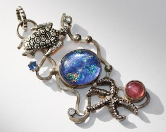 Turtle necklace with starfish, dichroic glass and pink tourmaline.
