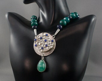 Emerald necklace. Emeralds and sapphires. Pendant clasp necklace, sterling silver