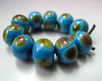 Handmade Lampwork Beads by GlassBeadArt... Raku on turquoise ...  SRA F12  ... 9x11mm