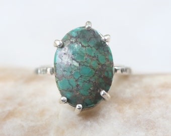 Green turquoise ring in silver bezel and prongs setting with sterling silver oxidized texture band