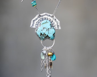 Turquoise necklace in silver bezel setting and silver fan with mix gemstone below turquoise beads secondary on silver oxidized chain