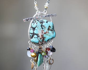 Turquoise pendant necklace in silver bezel setting and mix gemstone below with turquoise beads secondary on sterling silver oxidized chain