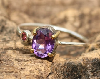 Faceted amethyst ring in silver and brass setting with side set amethyst/TP