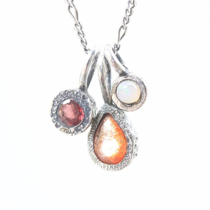 Three princess necklace,sunstone,garnet,opal gemstone pendant in silver bezel setting