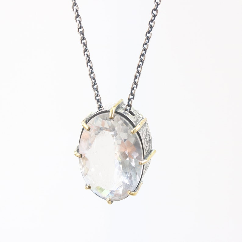 Oval faceted white topaz necklace in silver bezel and prongs setting with silver beads secondary on oxidized silver chain