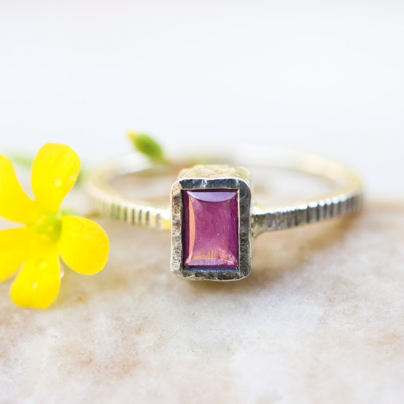 Pink sapphire in silver bezel setting with oxidized sterling silver texture design band