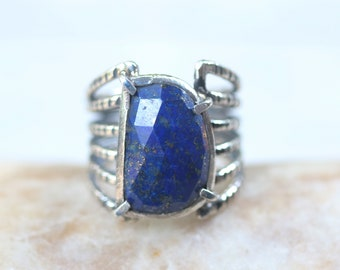 Faceted D shape Lapis Lazuli ring in silver bezel and prongs setting