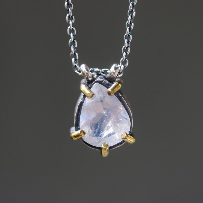 Teardrop moonstone pendant necklace in silver bezel and brass prongs setting with silver beads secondary on oxidized sterling silver chain