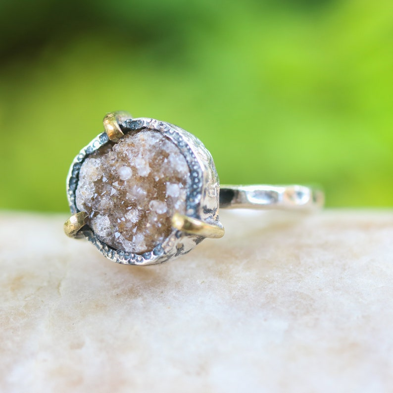 Brown round druzy quartz ring in silver bezel and brass prongs setting with sterling silver hammer texture band
