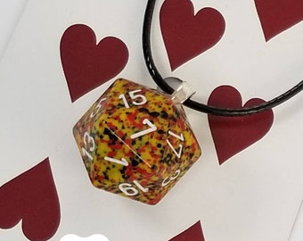 Yellow, Red, and Black Icosahedron Upcycled Vintage Dice Necklace   Get or give some playful style with a handmade dice necklace today!