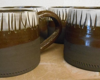 Set of Two Black Noir coffee mugs.