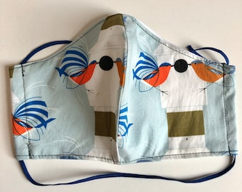 Face Masks with filter pocket, reusable, washable, two layers, elastic around head, quilters cotton, blue bids, wire pocket, wire