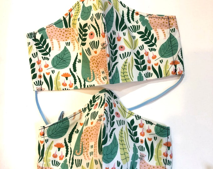 Featured listing image: Ethereal Jungle, Organic cotton , quilter's weight, Face Masks ,filter pocket, reusable, washable, two layers, elastic , wire insert