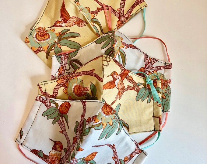 Featured listing image: Hummingbird Magnolia Organic Cotton Face Masks with filter and wire pocket , wire insert,  long elastic or adjustable ear loops.