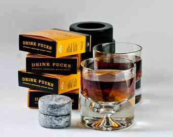 whisky rocks stones   DrinkPucks in rubber hockey puck case