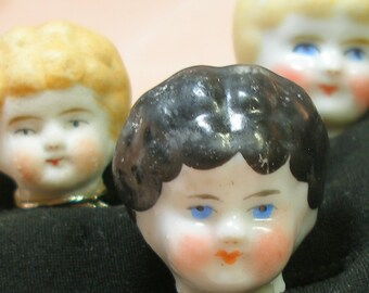 Antique DOLL ring. 1800s Victorian china head on sterling silver, Frozen Charlotte. Black haired doll only.