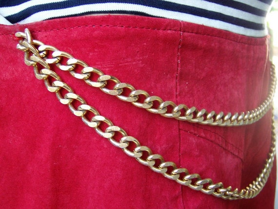 Red Hot suede shorts with chains