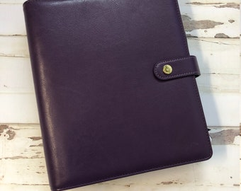 A5 Planner Ready to plan in, binder, inserts, stickers, clips, and embellishments. Plum colored.