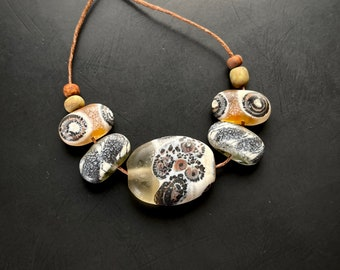 Handmade lampwork blown glass bead set by Lori Lochner amber bone black bronze boho beach tribal artisan jewelry necklace components tribal