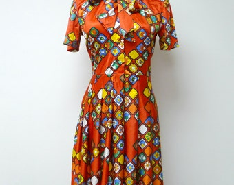 60s 70s floral print pleated dress . fits a small to medium