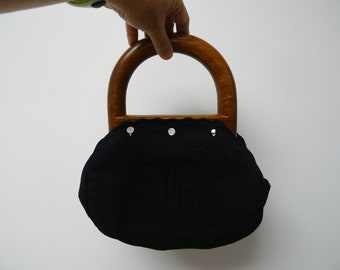 Veloso's gift shop . handmade embroideries . monogram M . wooden handle and black embroidered fabric bag