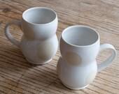 Two White on White Happy Couple mugs