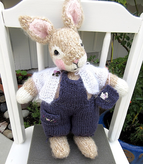 hand knitted bunny in blue cupcake dress