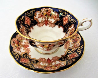 Royal Albert Bone China Tea Cup And Saucer Set In The Heirloom Pattern. Made In England