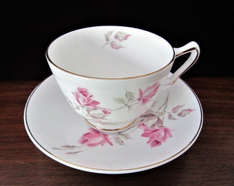 Crown Fine Bone China Tea Cup And Saucer In A Pink Rose Pattern. From Straffordshire England
