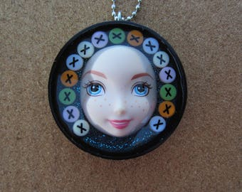 Kisses - upcycled plastic bottle cap doll face pendant