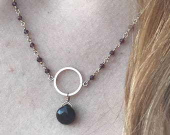 Raspberry Cubic Zirconia wire wrapped chain with smokey quartz teardrop pendent hanging from gold-filled circle.