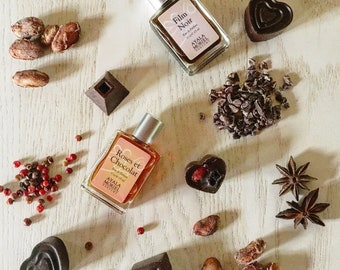Roses et Chocolat - three pleasures in one elegant flacon: a bouquet of red roses, melt-in-your-mouth chocolate truffles, and perfume