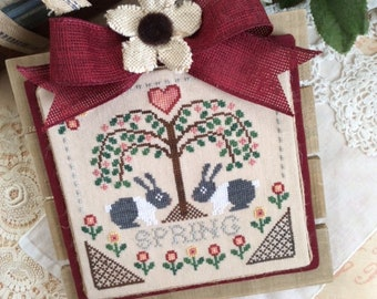 Cross Stitch Pattern Sheltering Tree Spring By Annie Beez Folk Art bunnies tree flowers hearts springtime sampler