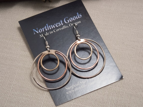 Triple hoops of bronze, copper, and German silver