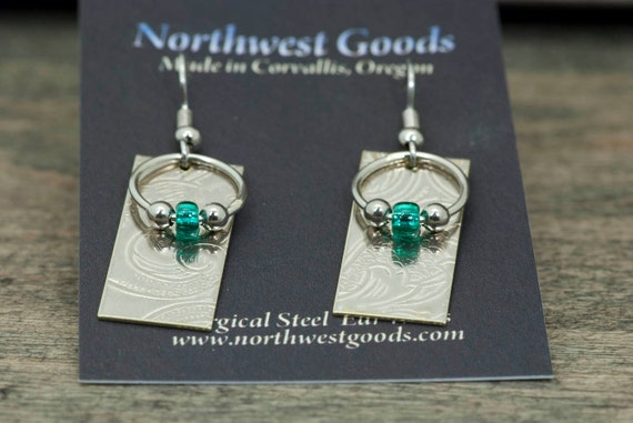 Sterling silver and nickel silver dangly patterned metal earrings with emerald green glass beads
