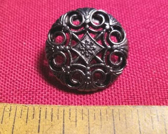 Single shanked button with a pierced classical pattern