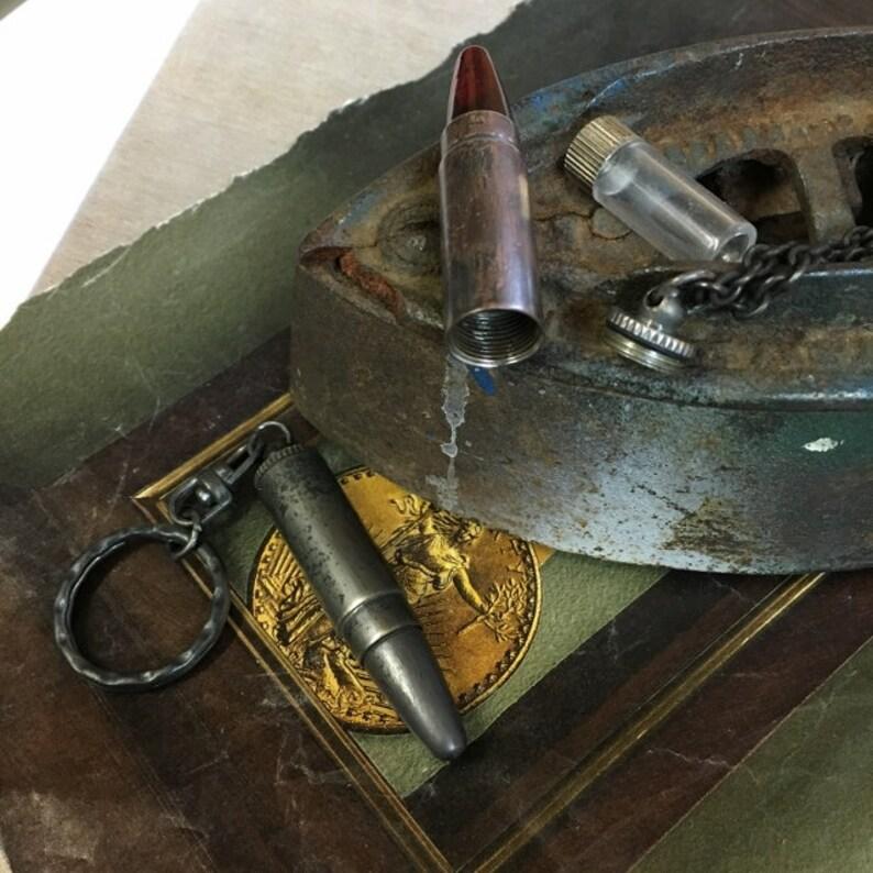 a7396571e62 Balle cachette porte-clés ou collier décadente foncé patiné