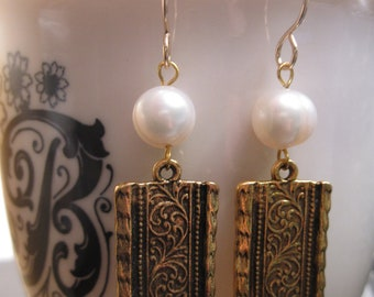 Pearl and Gold Ironwork Relief Charm
