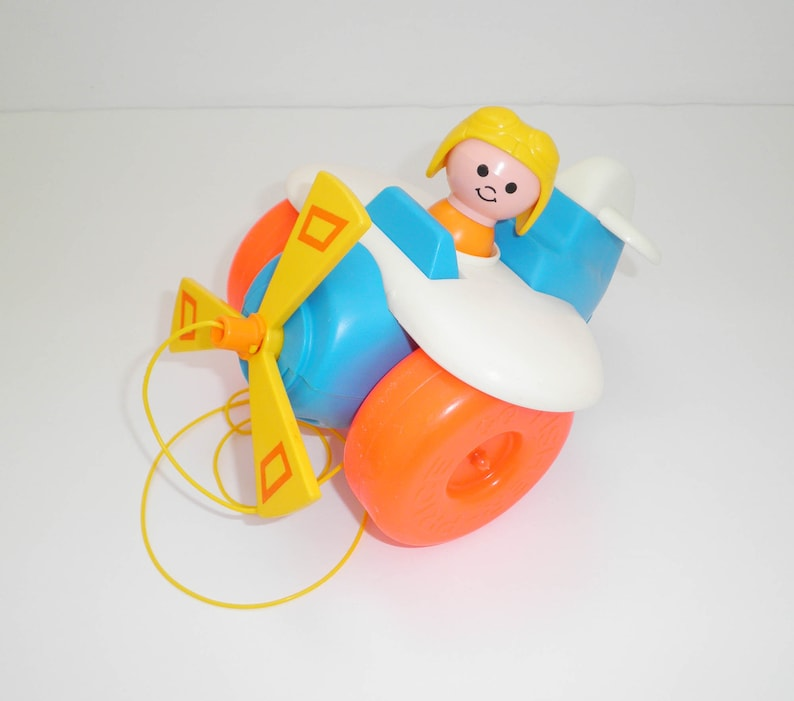 Nostalgic 1980/'s Fisher Price pull along vintage AIRPLANE toddler plane toy with pilot